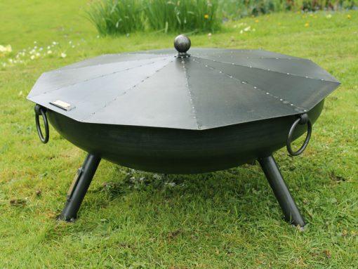 Snuffer Lid on Celeste Fire Pit in garden