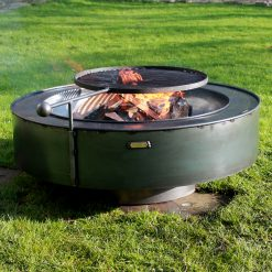 Circular 120 Ring fire pit with Swing Arm lit in garden