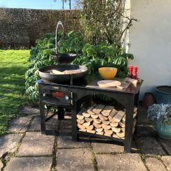Complete Outdoor Kitchen with fire bowl and log store in garden