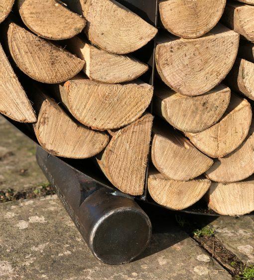Half Circular Log Store in garden with logs