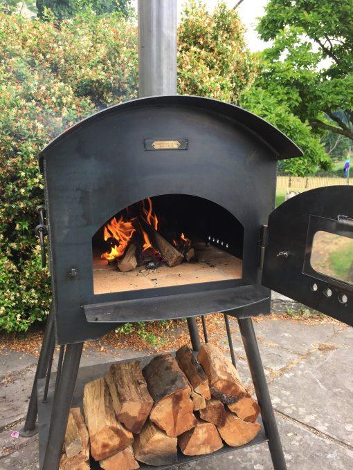 Traditional Pizza Oven lit with door open