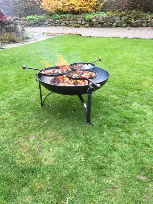 Plain Jane 90 with 3 swing arm BBQ racks in garden