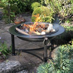 Saturn fire pit lit in garden