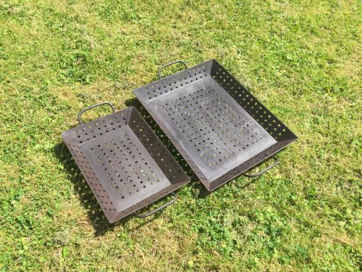 2 vegetable trays side by side on lawn